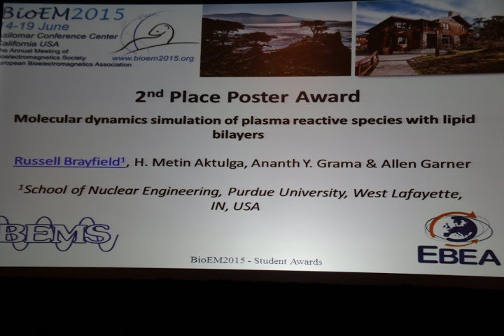 Photograph of 2nd place Poster award winner